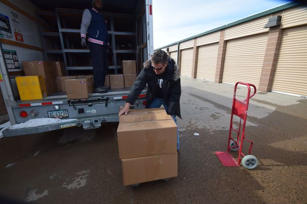 D. Nick Dunbar and Marc Montoni assisting with records move, Park Colorado